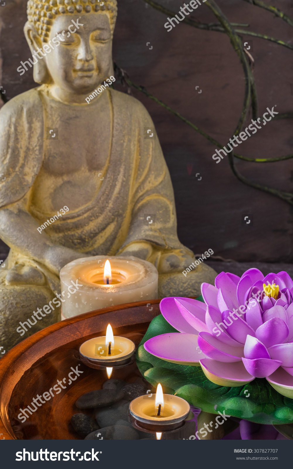 Statue meditating buddha lotus flower floating stock photo edit now statue of meditating buddha and a lotus flower floating with candles izmirmasajfo