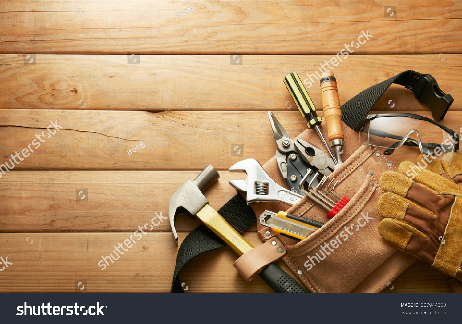tools in tool belt on wood planks with copy space #307944350