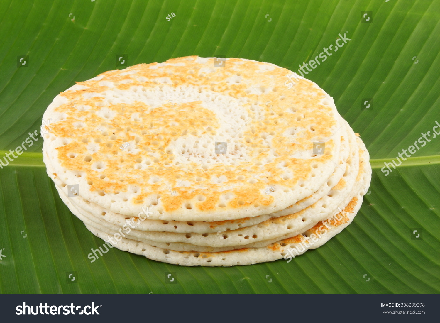 Traditional South Indian breakfast Dosa served on banana leaf