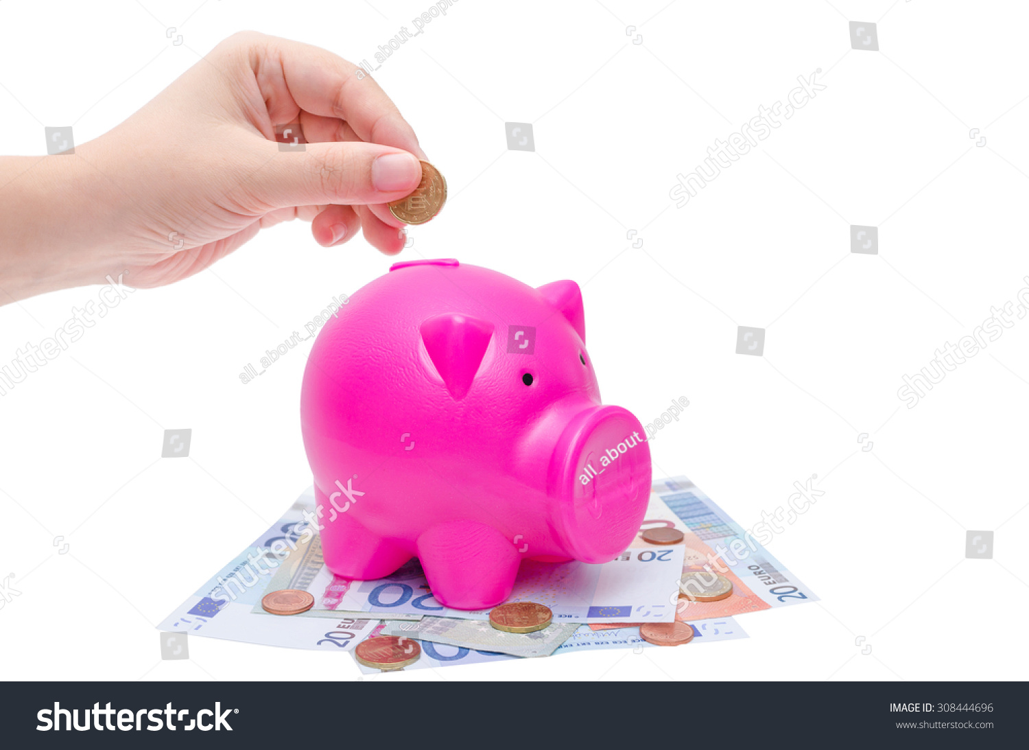 female hand putting coin into piggy stock photo 308444696