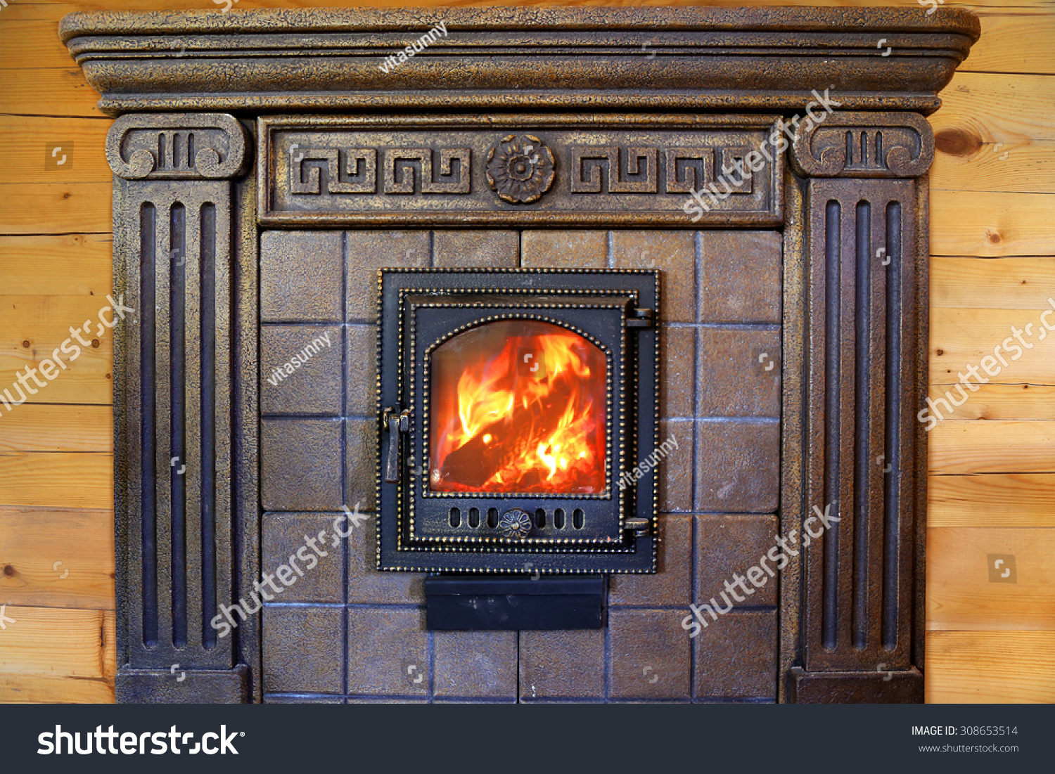 Design Burning Fireplace With Cast Iron Door Near The