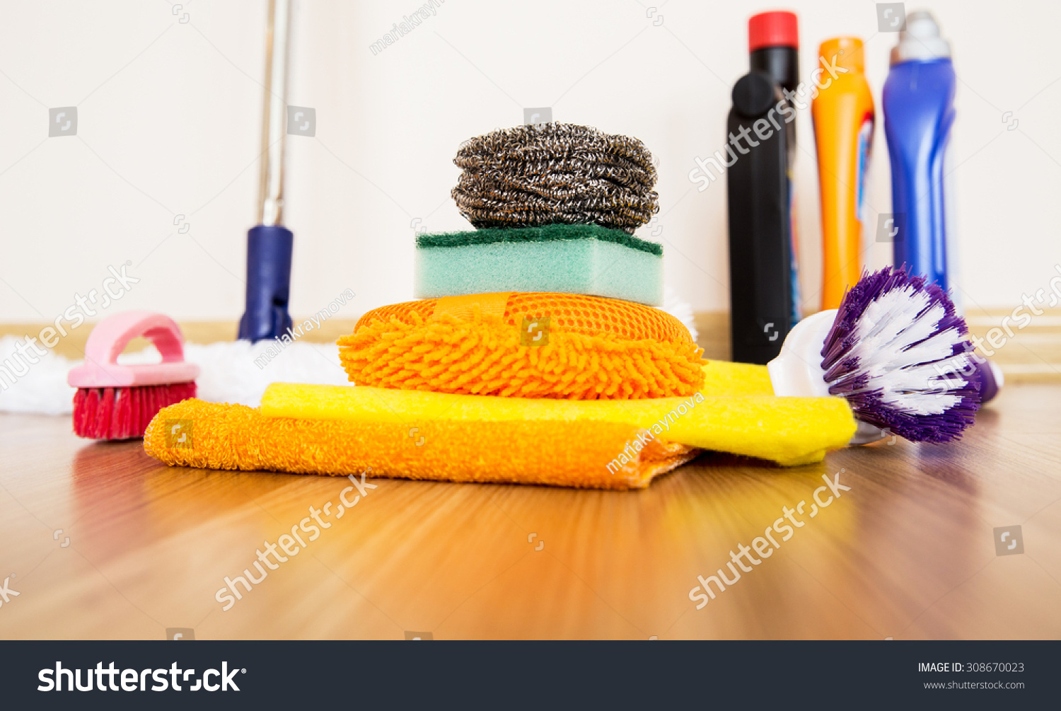 House Cleaning Supplies On Wooden Floor Stock Photo