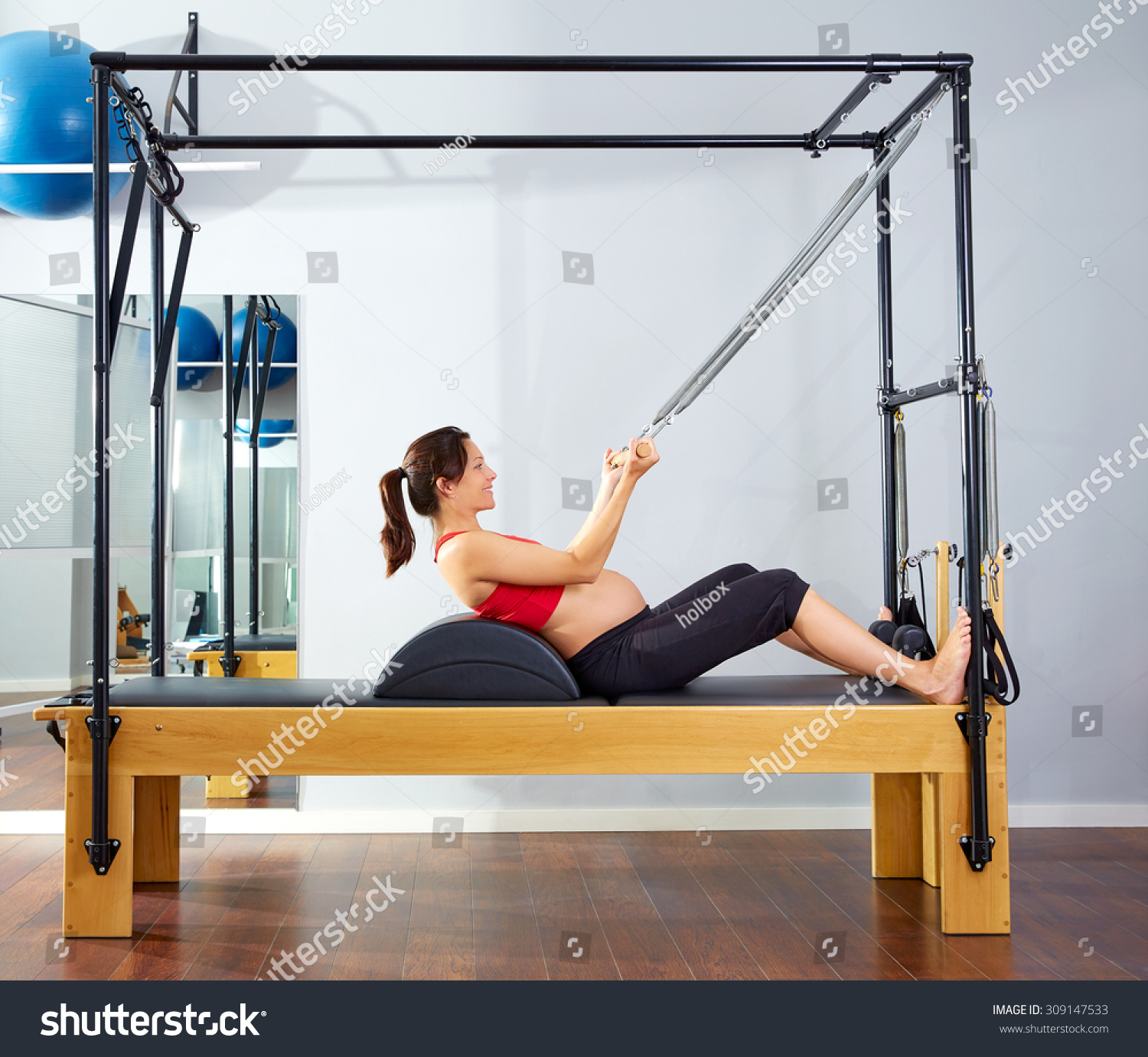 Woman Pilates Chair Exercises Fitness Stock Photo: Pregnant Woman Pilates Reformer Roll Cadillac Stock Photo