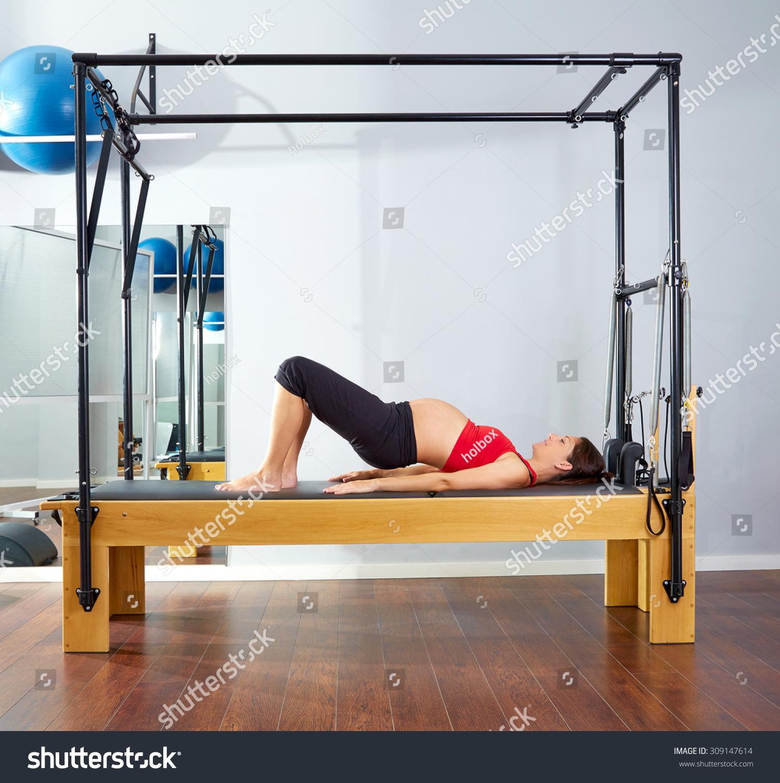 Woman Pilates Chair Exercises Fitness Stock Photo: Pregnant Woman Pilates Reformer Shoulder Bridge Exercise