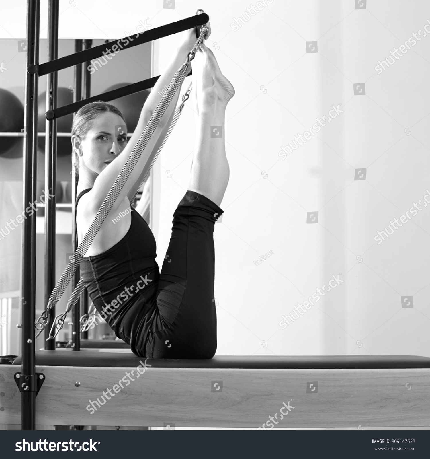 Woman Pilates Chair Exercises Fitness Stock Photo: Pilates Woman In Reformer Monki Exercise At Gym Indoor