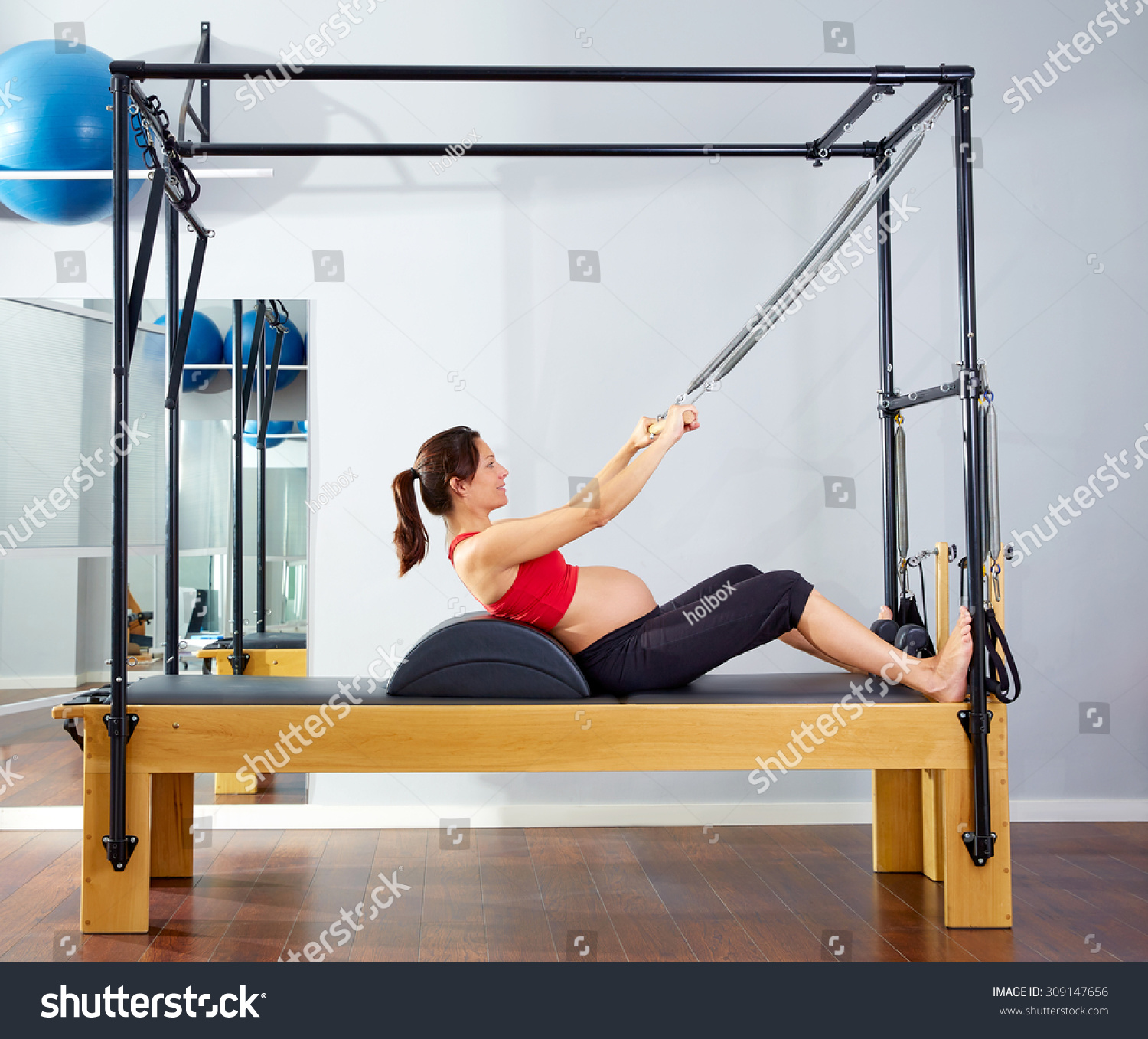 Woman Pilates Chair Exercises Fitness Stock Photo: Pregnant Woman Pilates Reformer Roll Up Cadillac Exercise