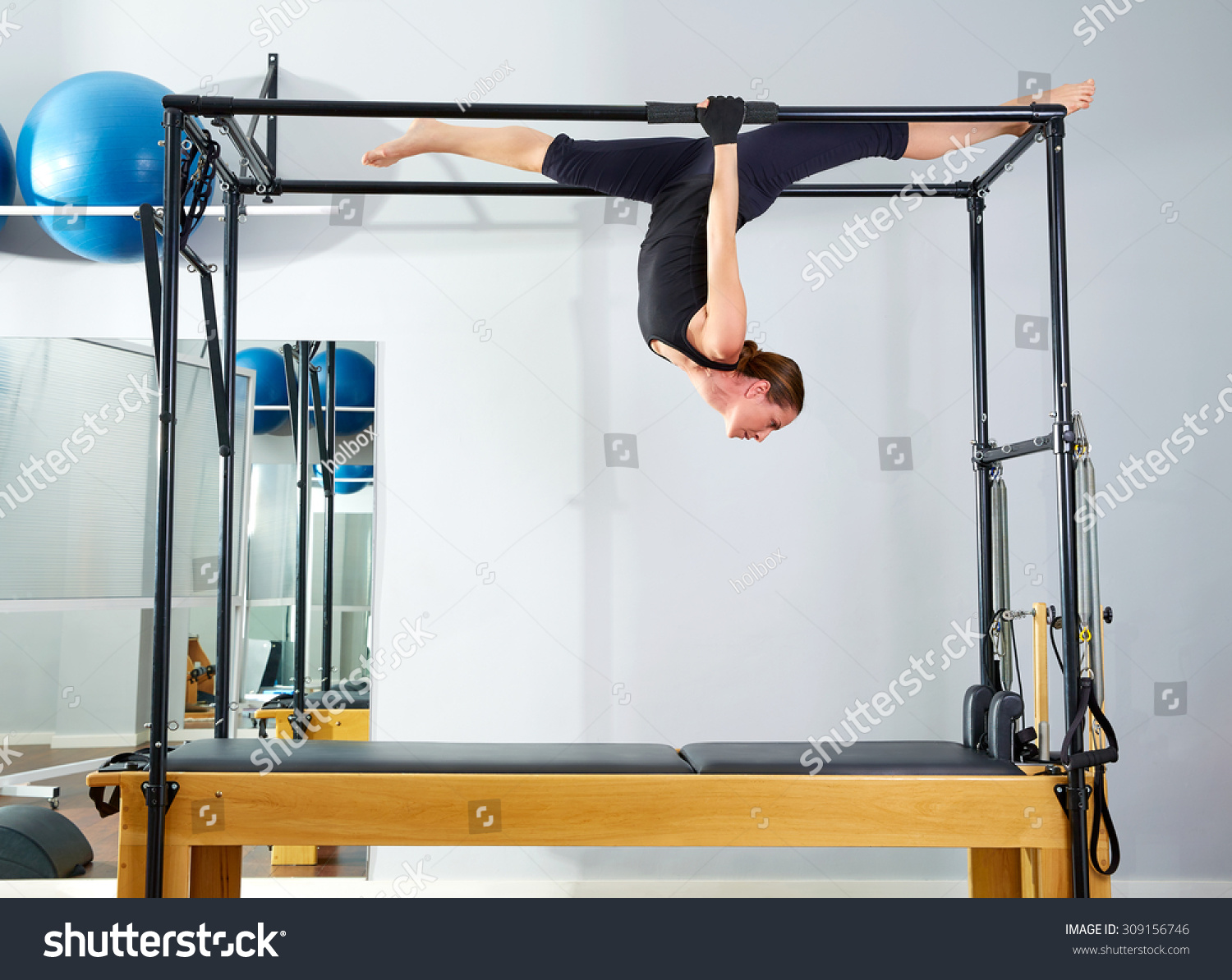Pilates woman cadillac walk over reformer stock photo for Gimnasio pilates