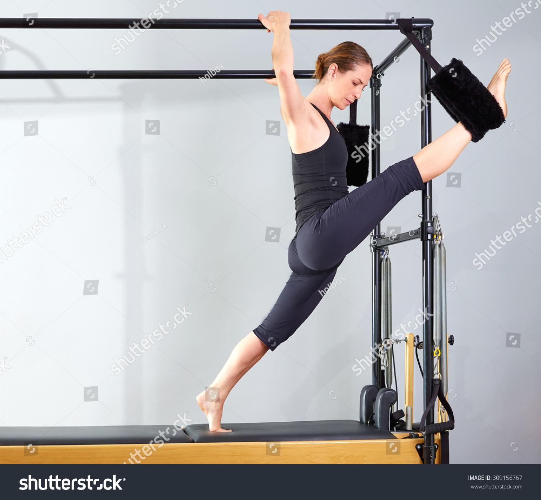 Woman Pilates Chair Exercises Fitness Stock Photo: Pilates Woman Cadillac Split Legs Stretch Stock Photo