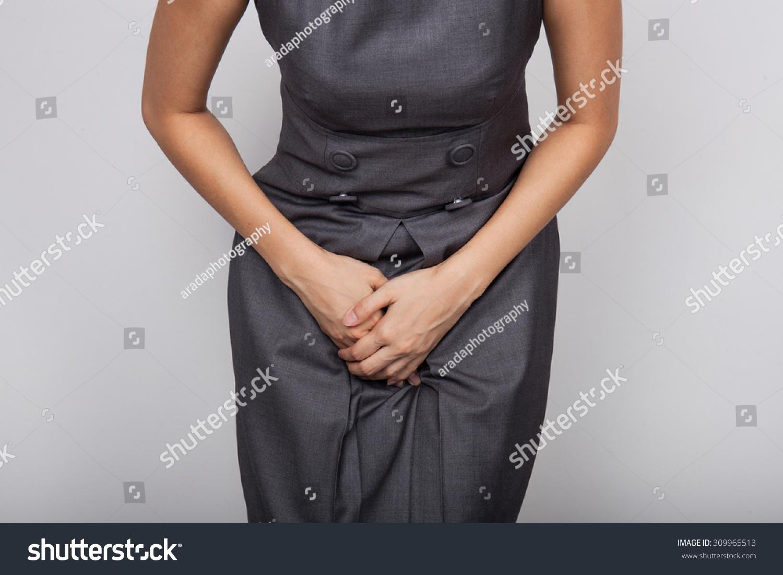 Girl hold pee