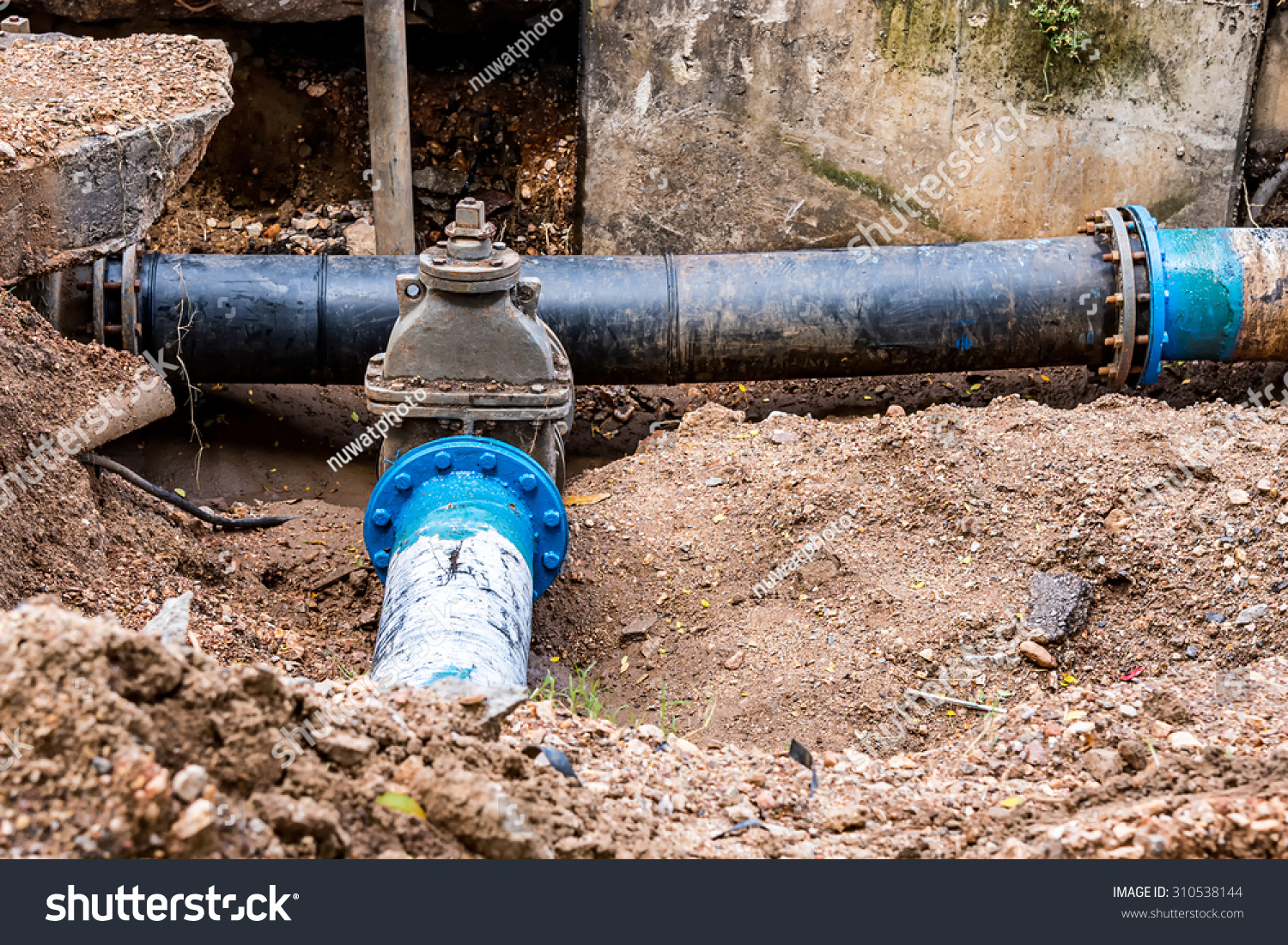Water pvc plastic pipes ground during stock photo for Plastic plumbing pipes
