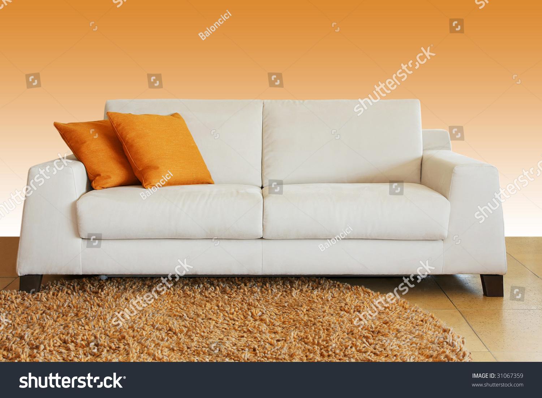 White Leather Sofa With Two Orange Pillows Stock Photo