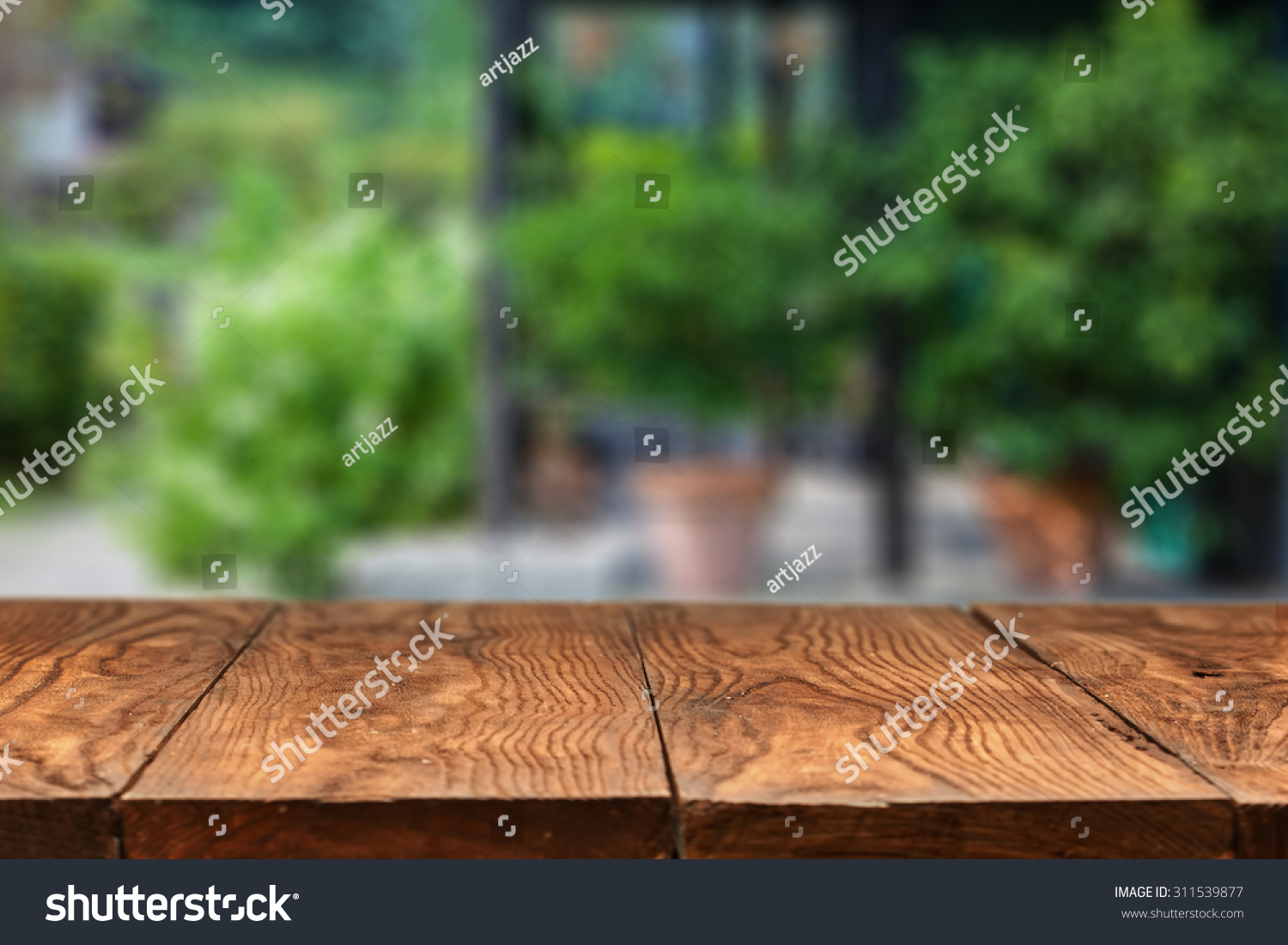 empty wooden table against summer backyard stock photo 311539877