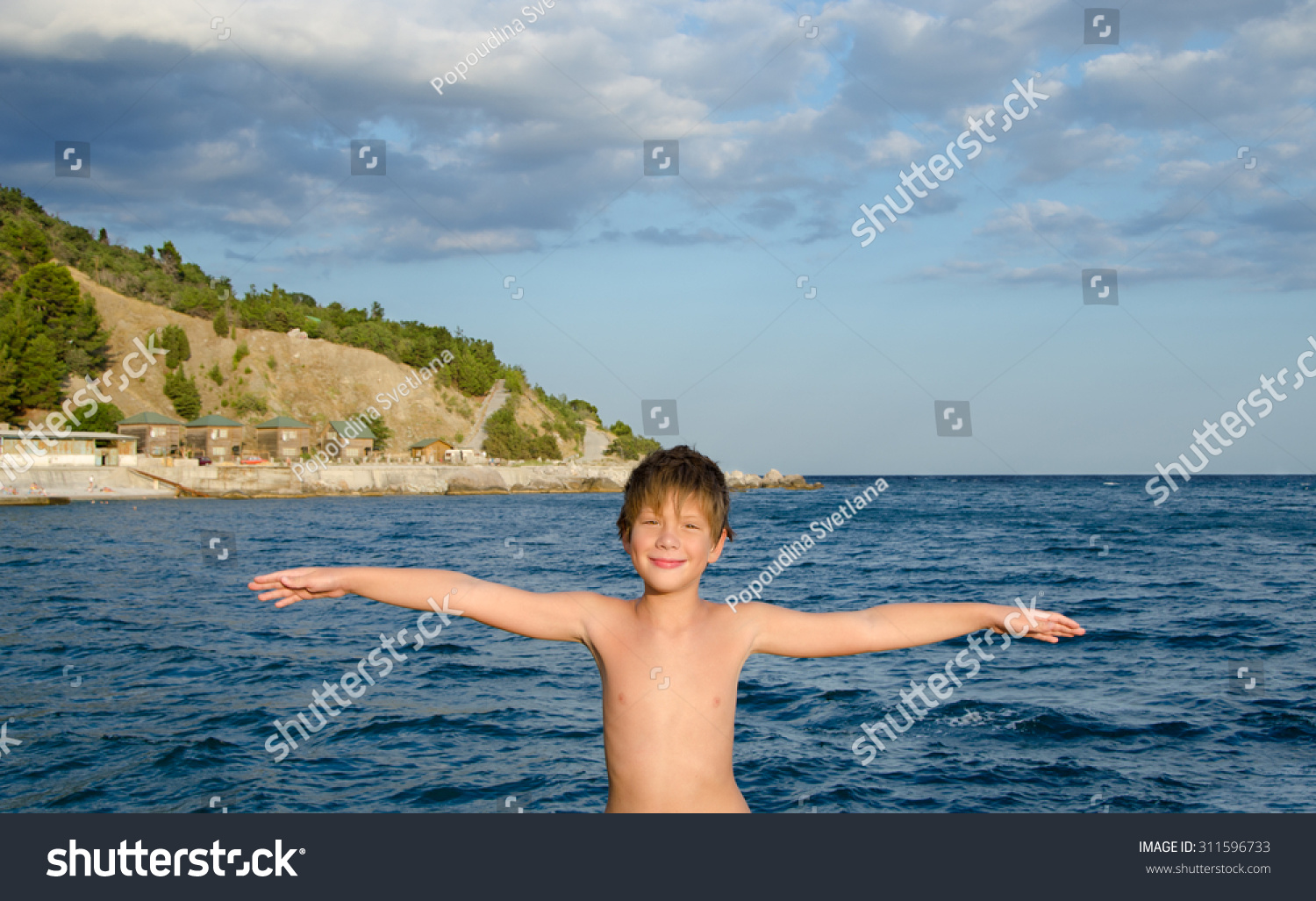 azov boy portrait of happy smiling boy with outstretched arms, embrace the whole  world against the backdrop