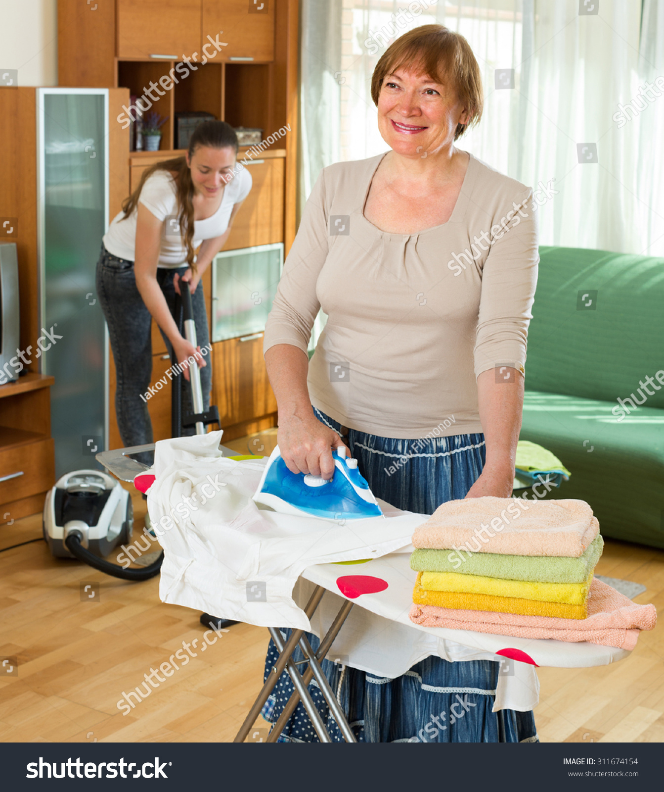 Mature woman young girl cleaning home stock photo for House cleaning stock photos