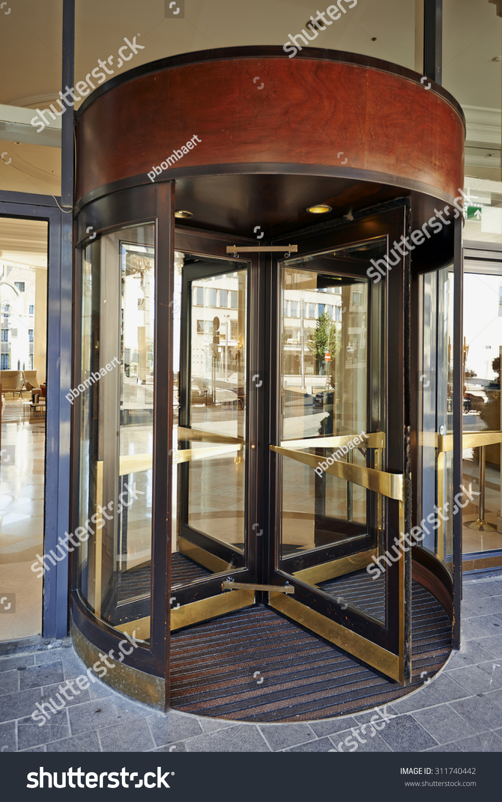 Details Of A Modern Hotel Entrance Glass Doors And Illumination