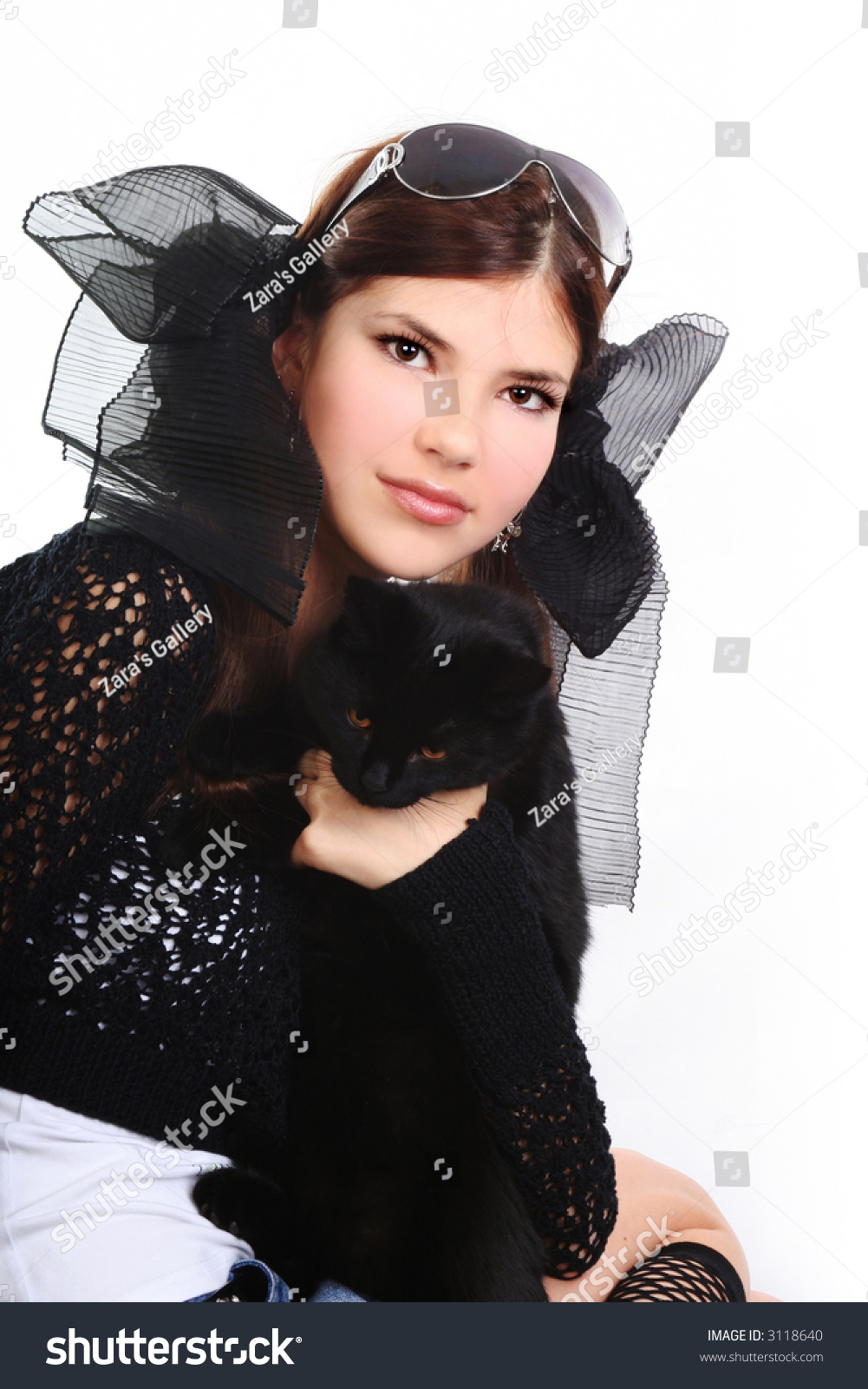 young pretty woman black pussy cat stock photo (100% legal