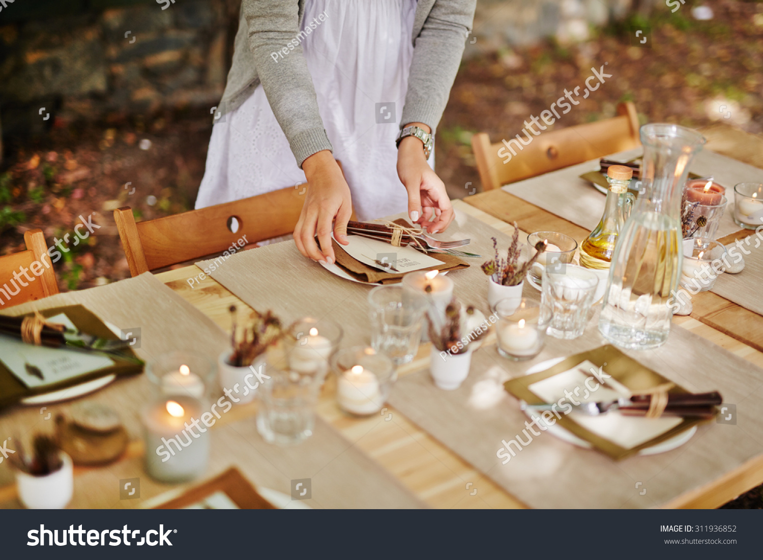 Thanksgiving dinner table being served for guests by waitress