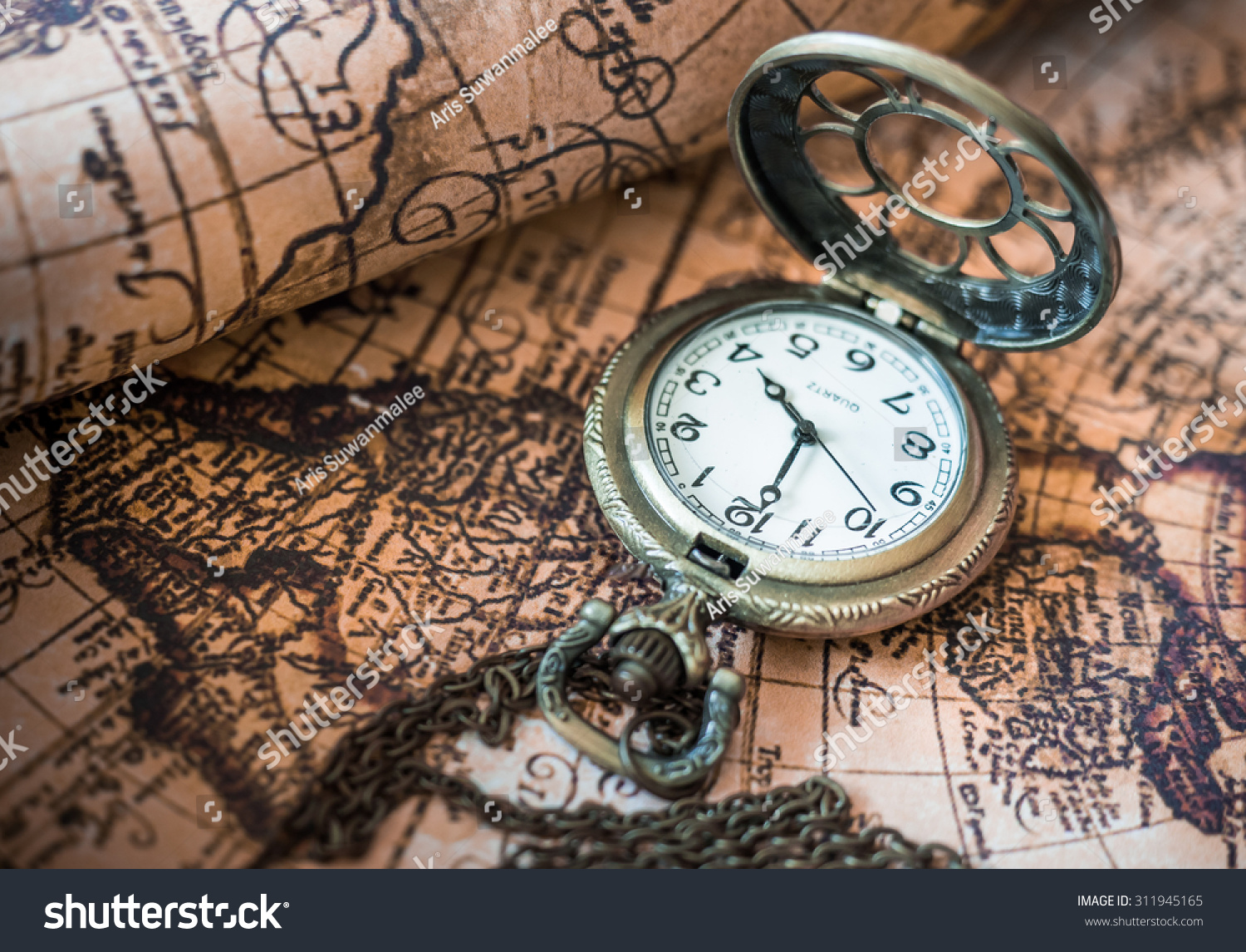 Antique pocket watch on ancient map stock photo 311945165 antique pocket watch on ancient map background gumiabroncs Choice Image