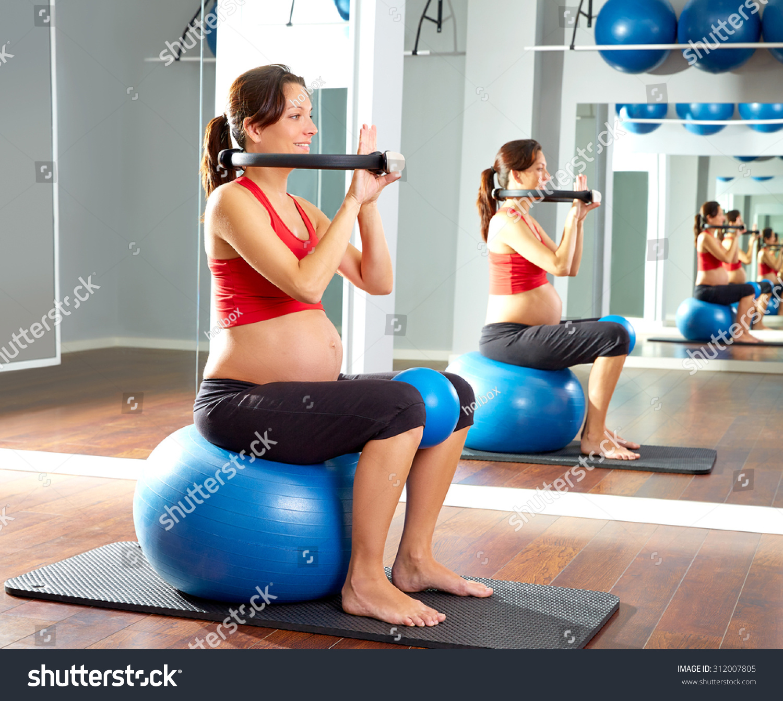 Woman Pilates Chair Exercises Fitness Stock Photo: Pregnant Woman Pilates Exercise Magic Ring Stock Photo