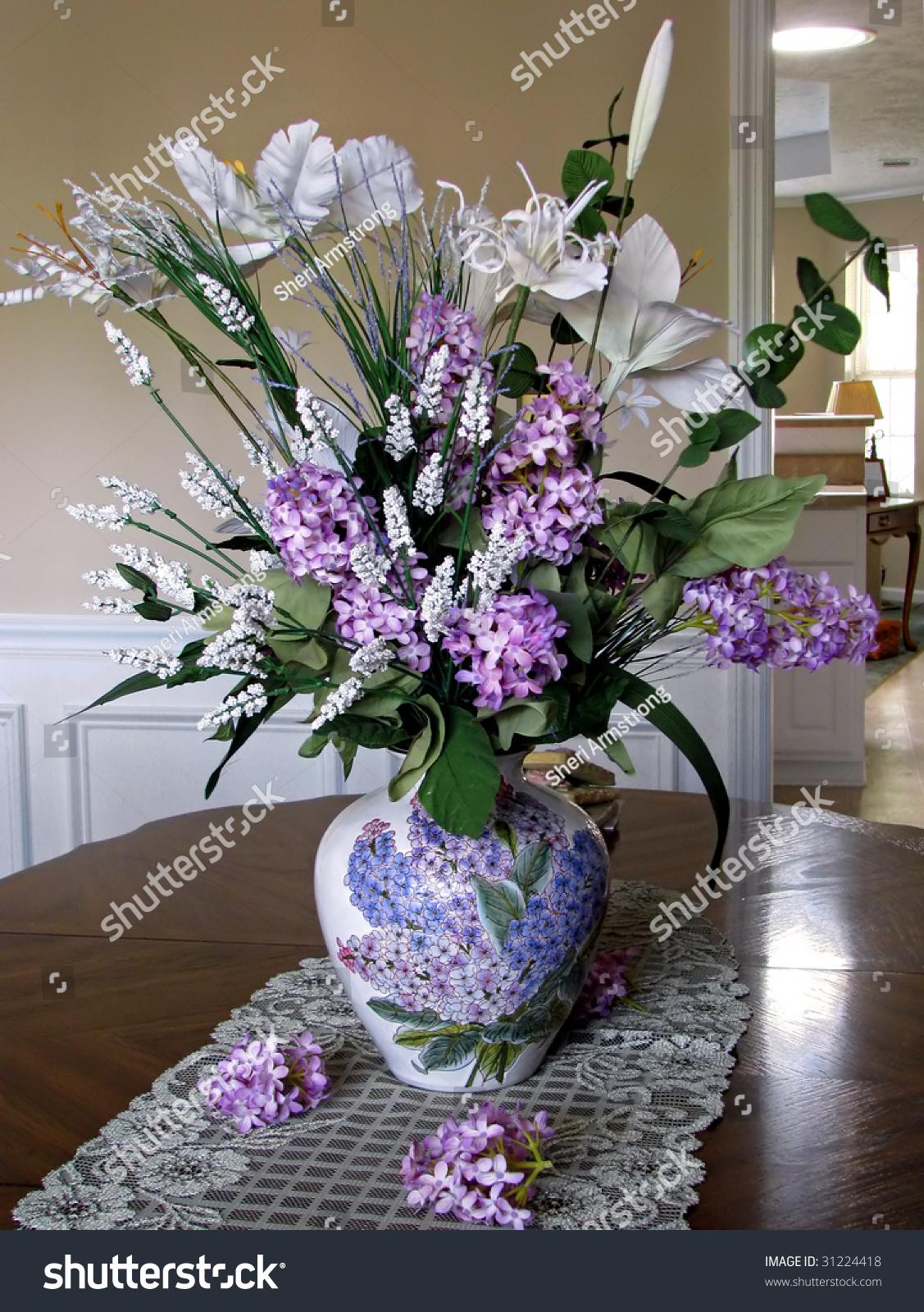 Beautiful Silk Lilac Floral Arrangement Table Stock Photo