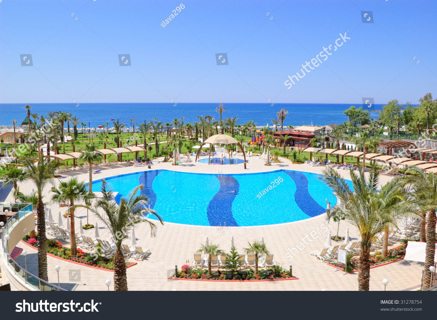 Swimming pool area in popular hotel antalya turkey stock for Swimming pool area