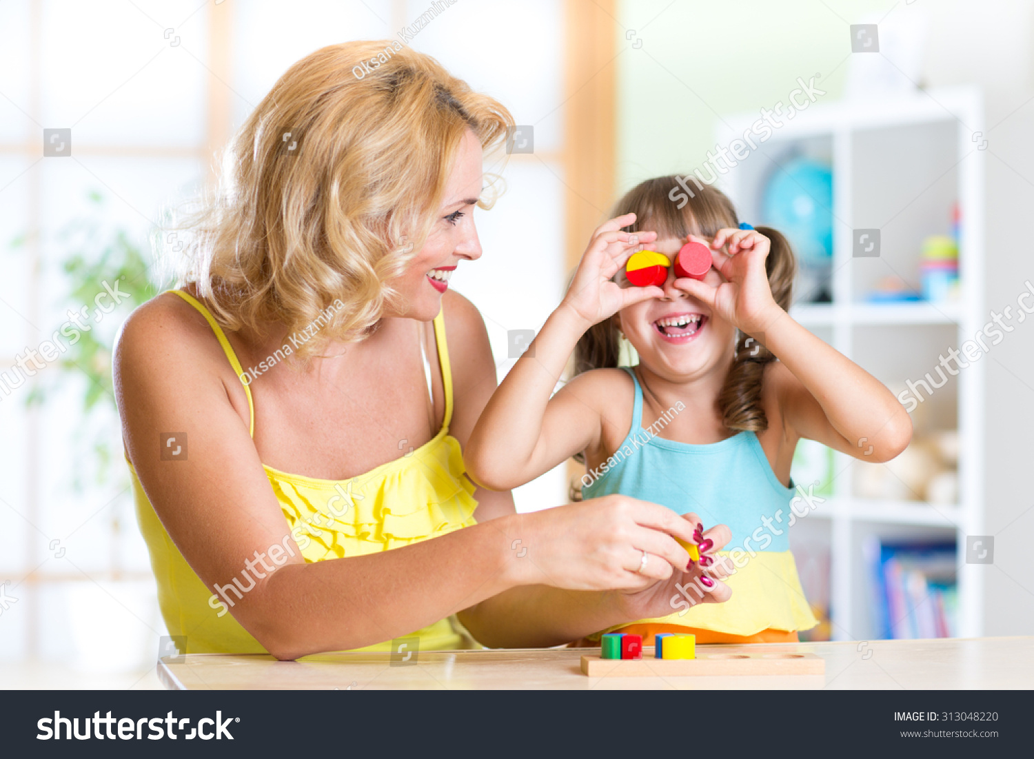 Mom Play Toys : Mother child daughter have fun playing stock photo