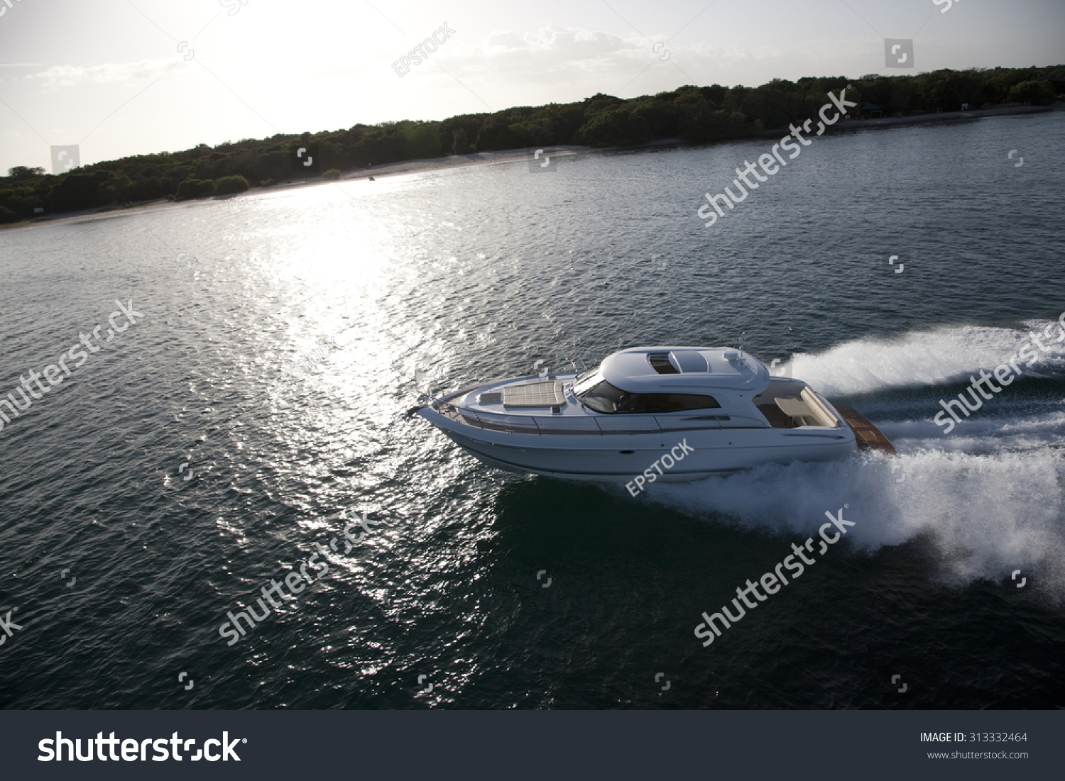 Image Of A Small Motor Boat Sailing In A Sea Across A