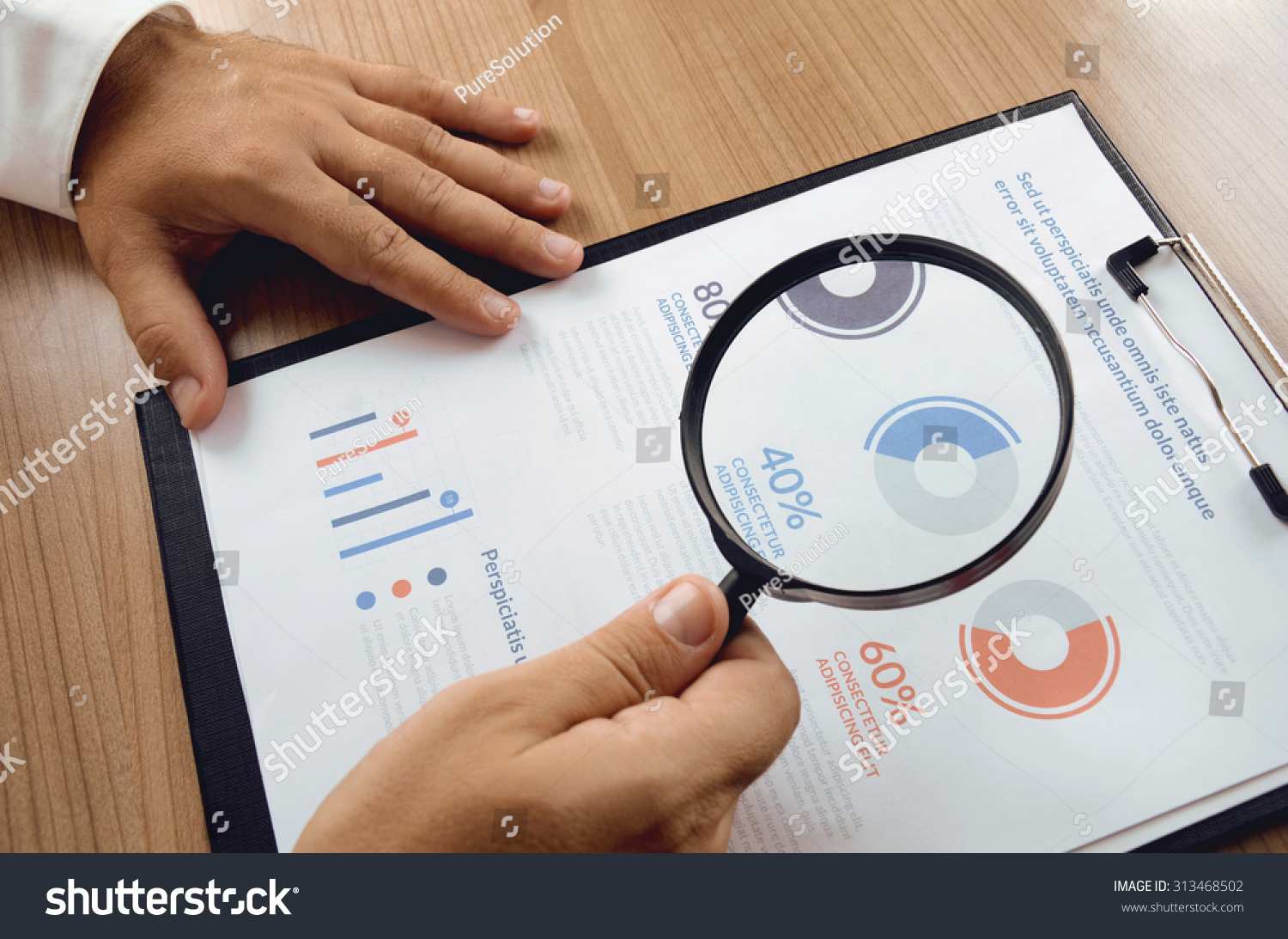 Technology Management Image: Market Research Businessman Hand Holding Magnifier Stock