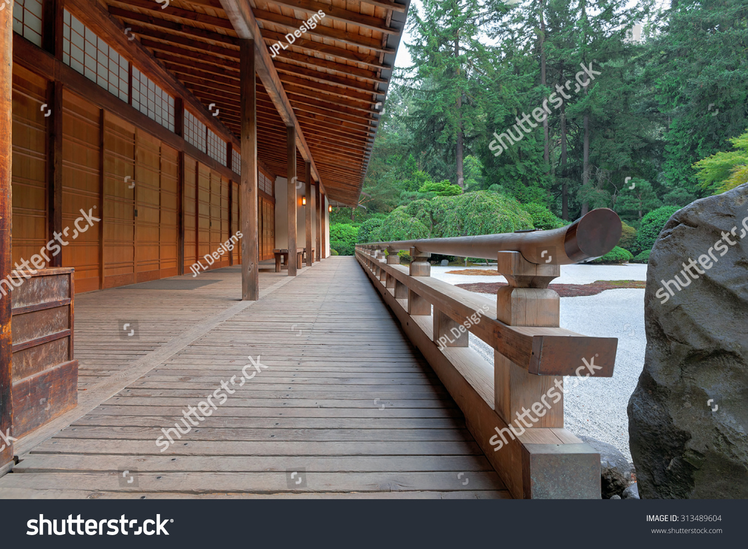 Stone path with wood entry structure and landscaping rocks for Japanese garden structures wood