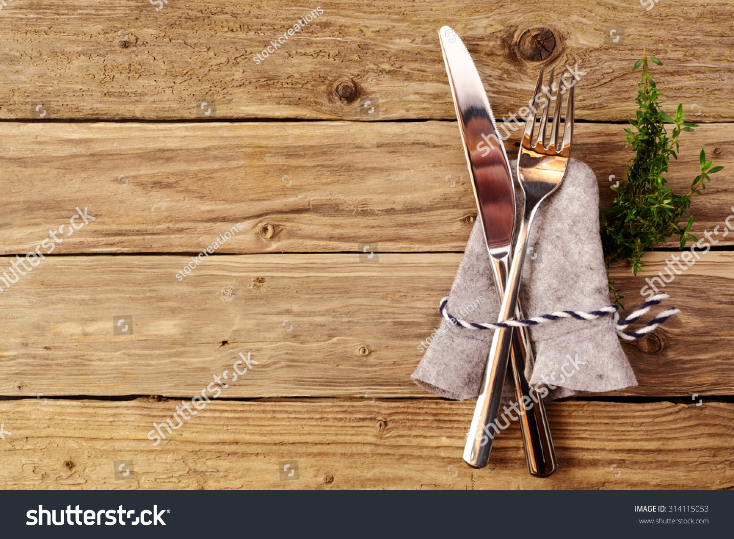 Bavarian cutlery on wooden table copyspace stock photo for Alpine cuisine silverware