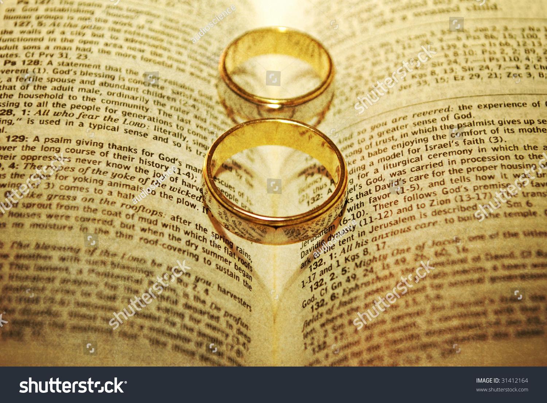 stylized wedding rings on bible stock photo edit now 31412164