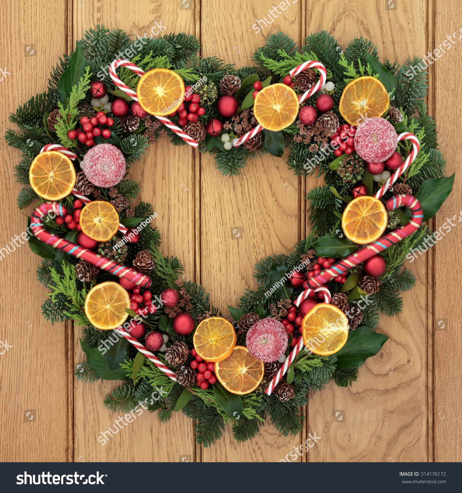 Fruit over the door christmas decoration - Christmas Heart Shaped Wreath With Dried Fruit Candy Canes Bauble Decorations Holly
