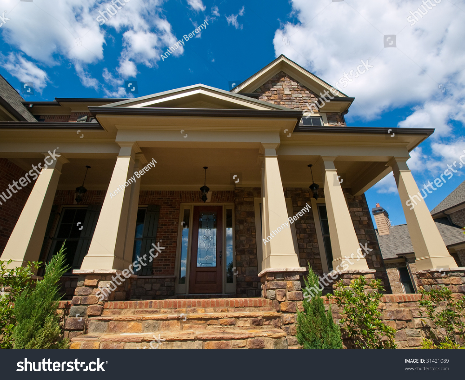 Luxury model home exterior column entrance extreme view for Luxury home models