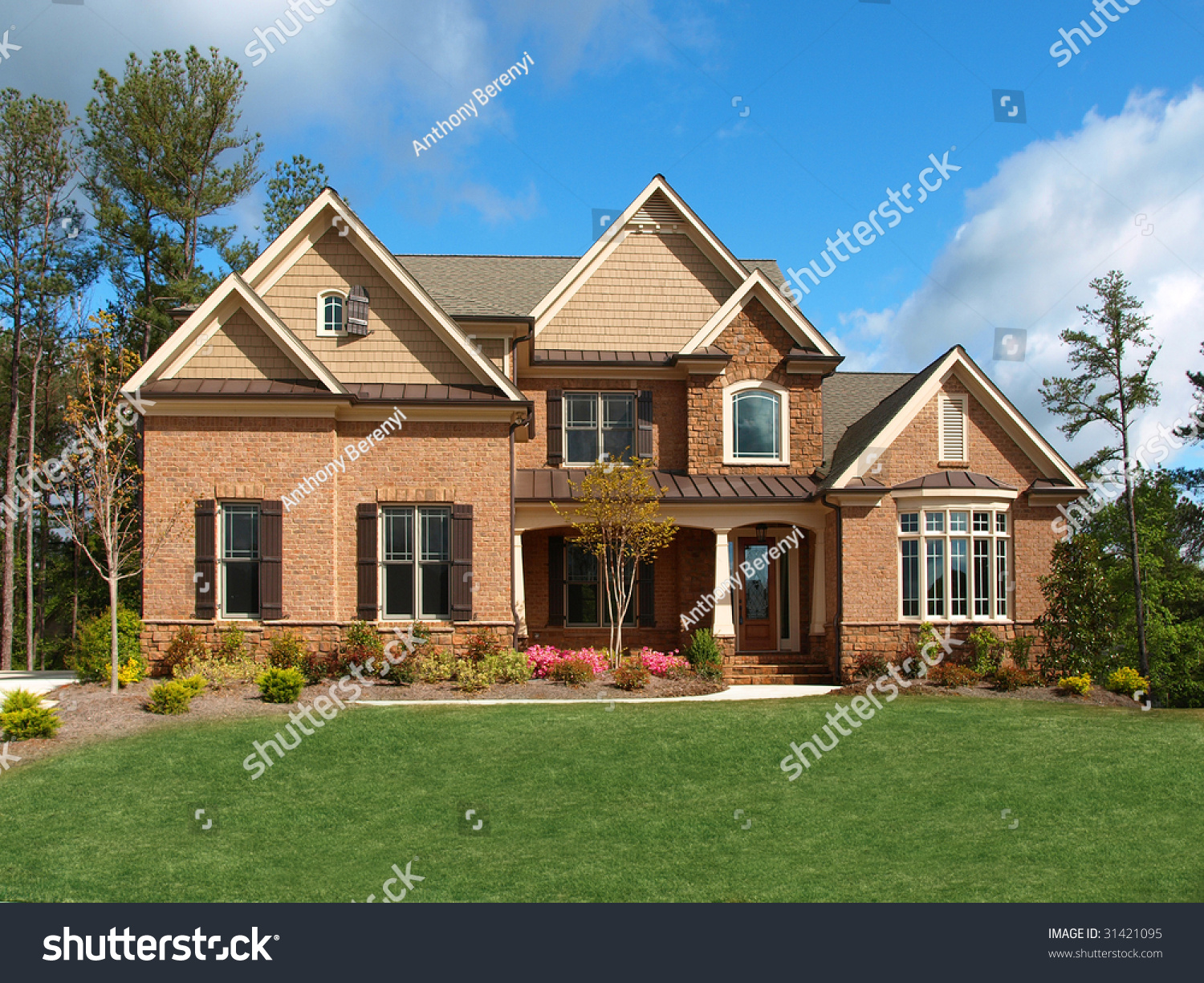 Luxury model home exterior with yard front view stock for Luxury home models