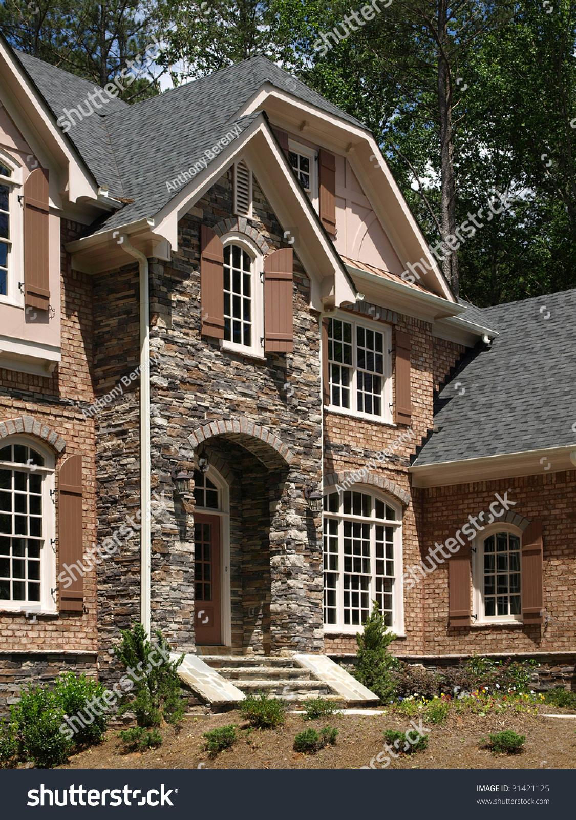 model luxury home exterior stone entrance corner view