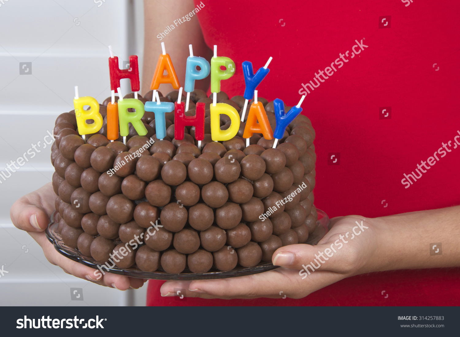 Young Girl Holding Chocolate Birthday Cake Stock Photo Edit Now
