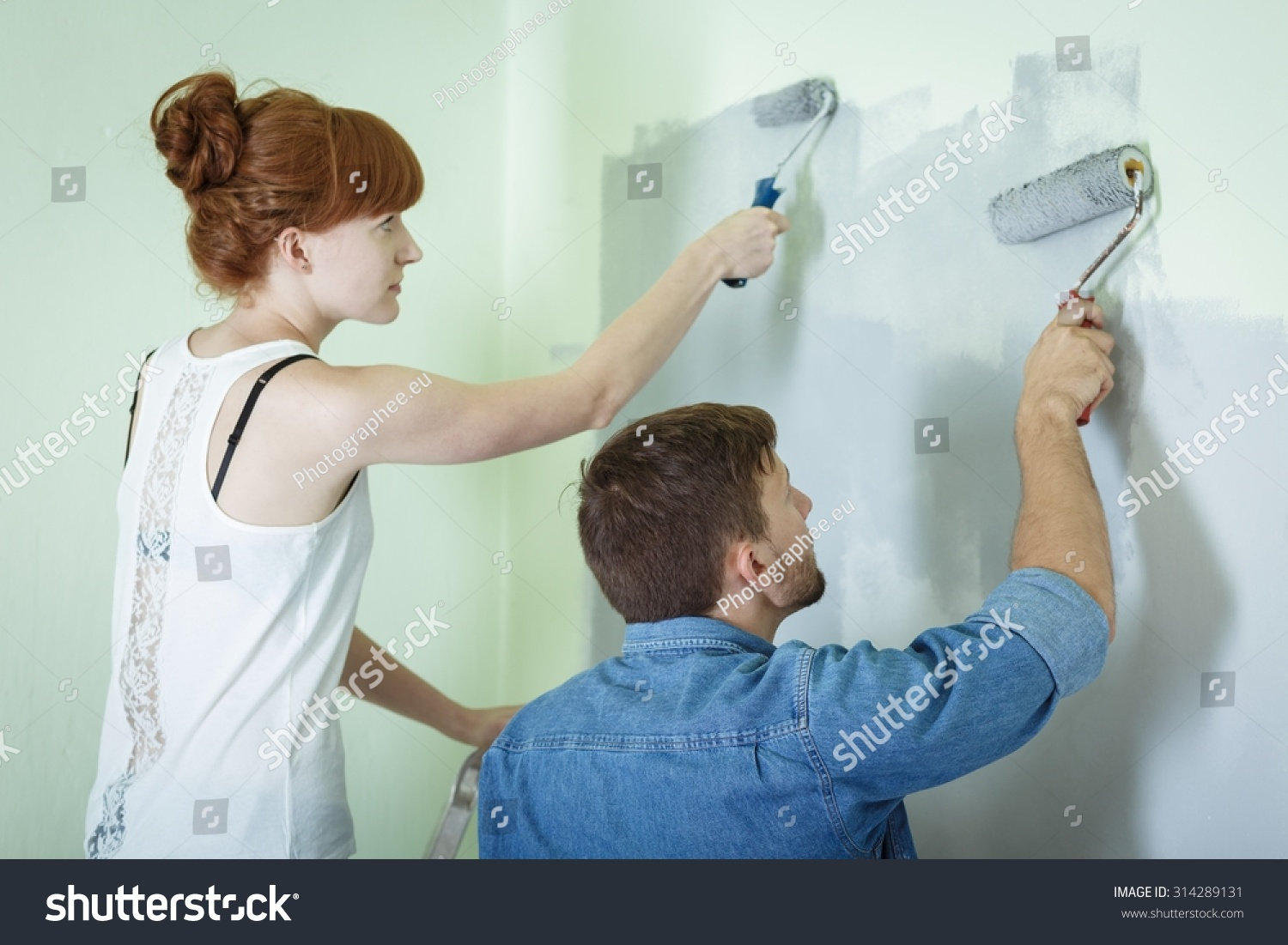 Save To A Lightbox Young Woman Redecorating Her House