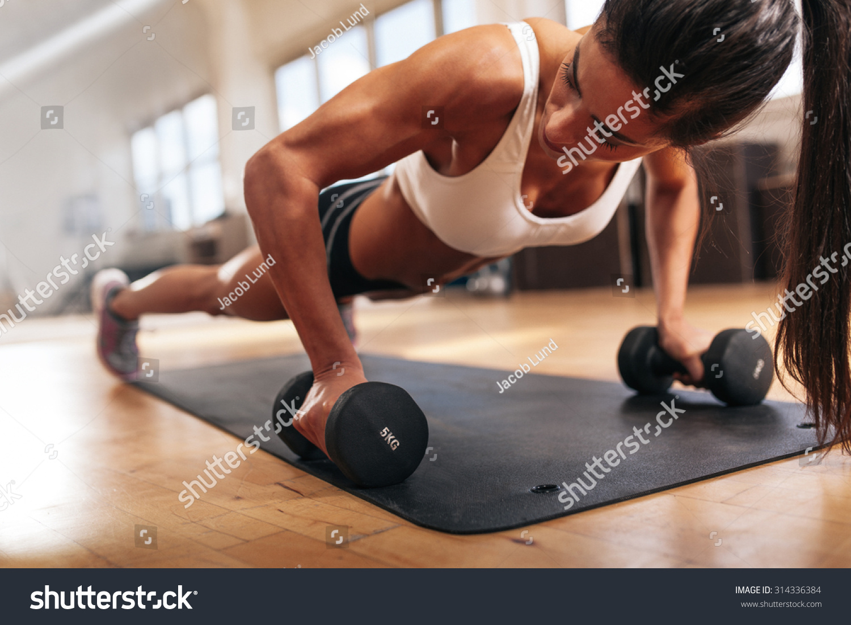 gym woman doing pushup exercise dumbbell stock photo 314336384 shutterstock. Black Bedroom Furniture Sets. Home Design Ideas