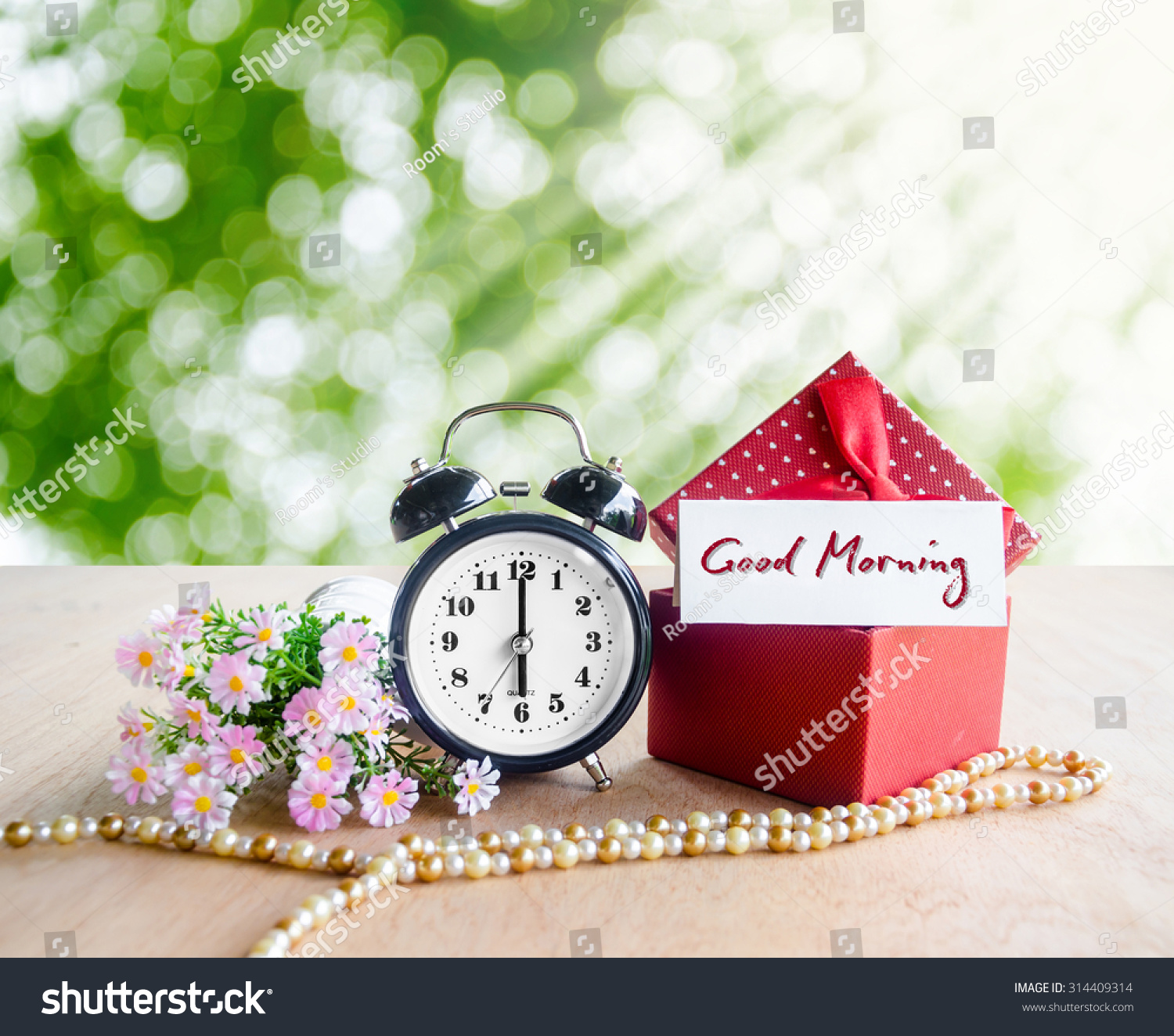 Good morning tag alarm clock gift stock photo royalty free good morning tag and alarm clock with gift box on spring background negle Choice Image