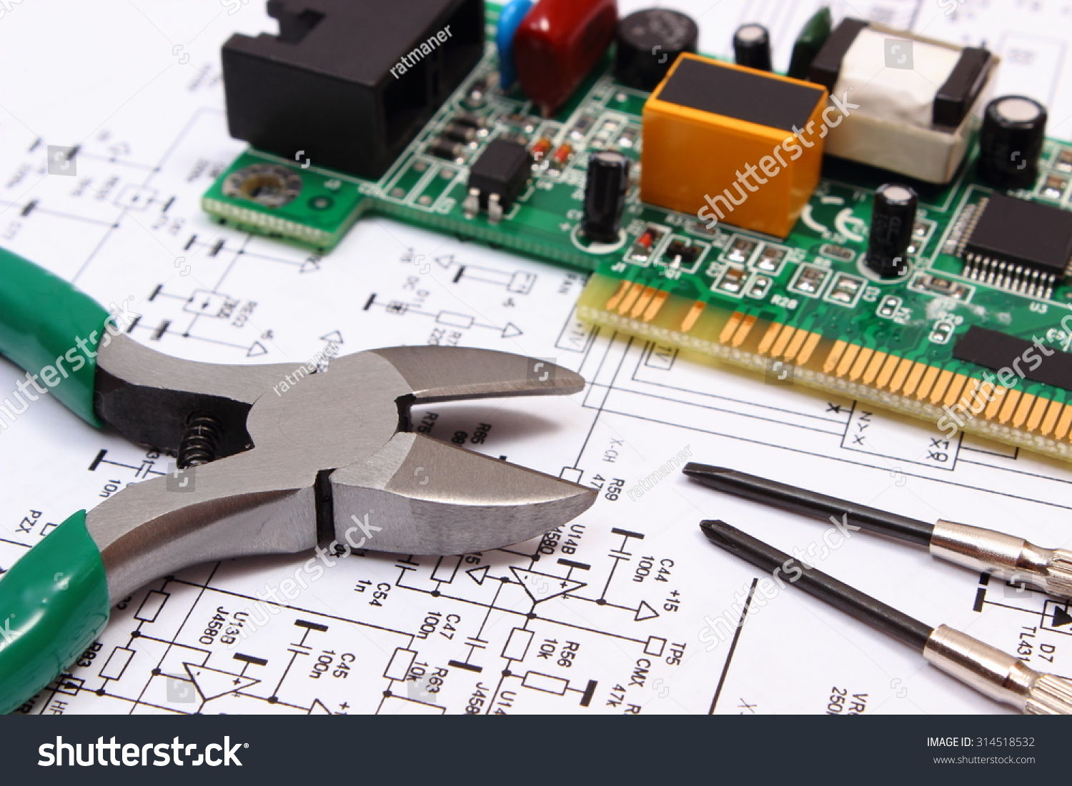 Royalty Free Printed Circuit Board With Electrical 314518532 Stock Detail Of A Image Components And Precision Tools Lying On Construction Drawing Electronics