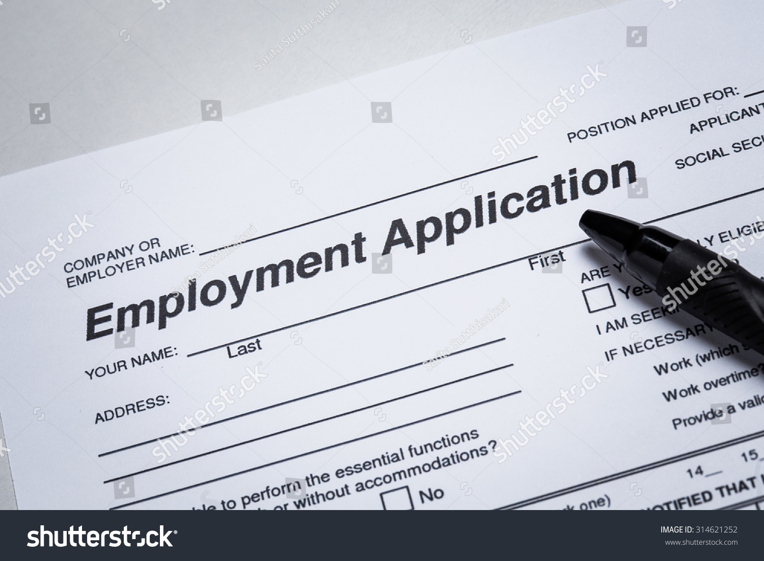royalty completing an job application form  completing an job application form focus on heading 314621252