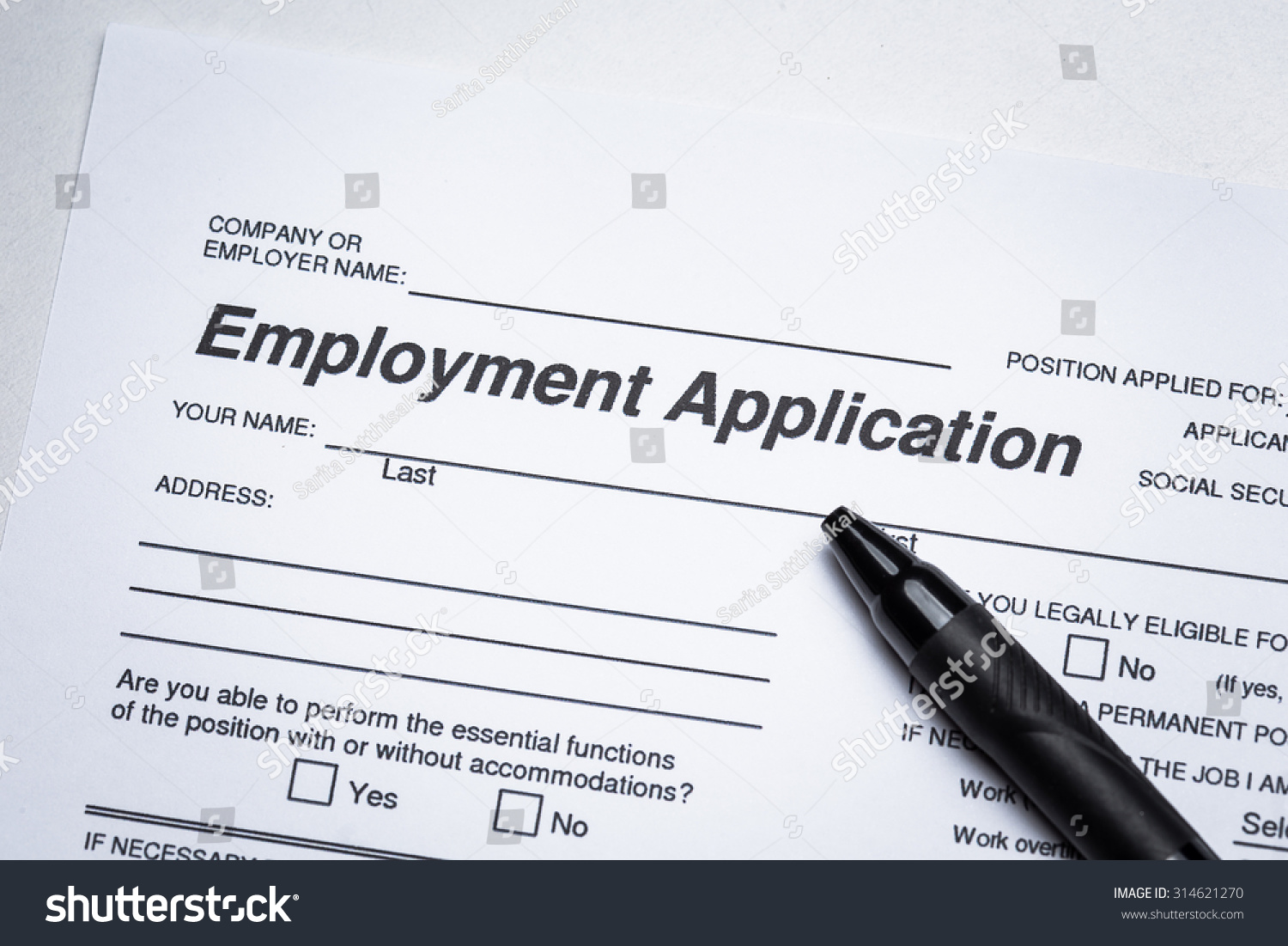 royalty completing an job application form  completing an job application form focus on heading 314621270
