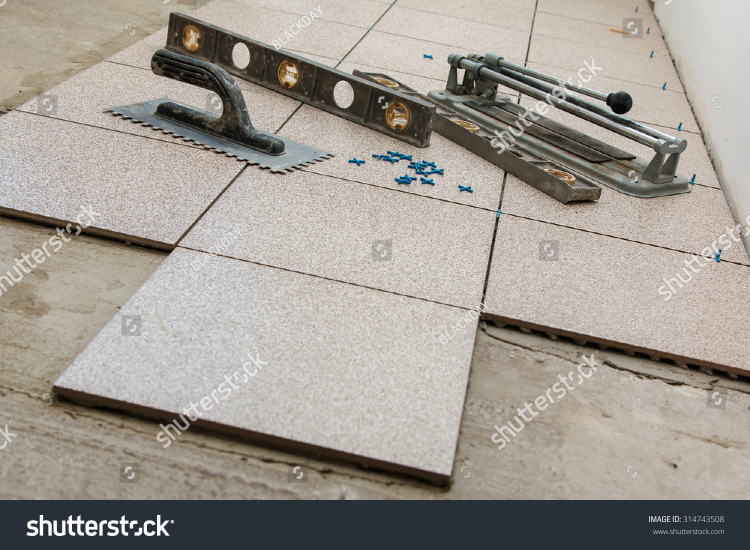Installation floor tiles ceramic tiles different stock photo installation of floor tiles ceramic tiles and different tools dailygadgetfo Gallery
