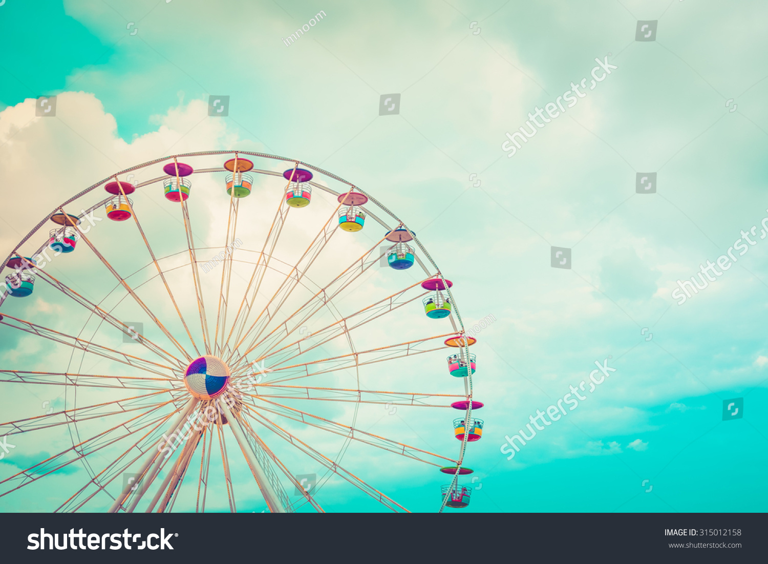 Ferris wheel on cloudy sky background vintage color #315012158