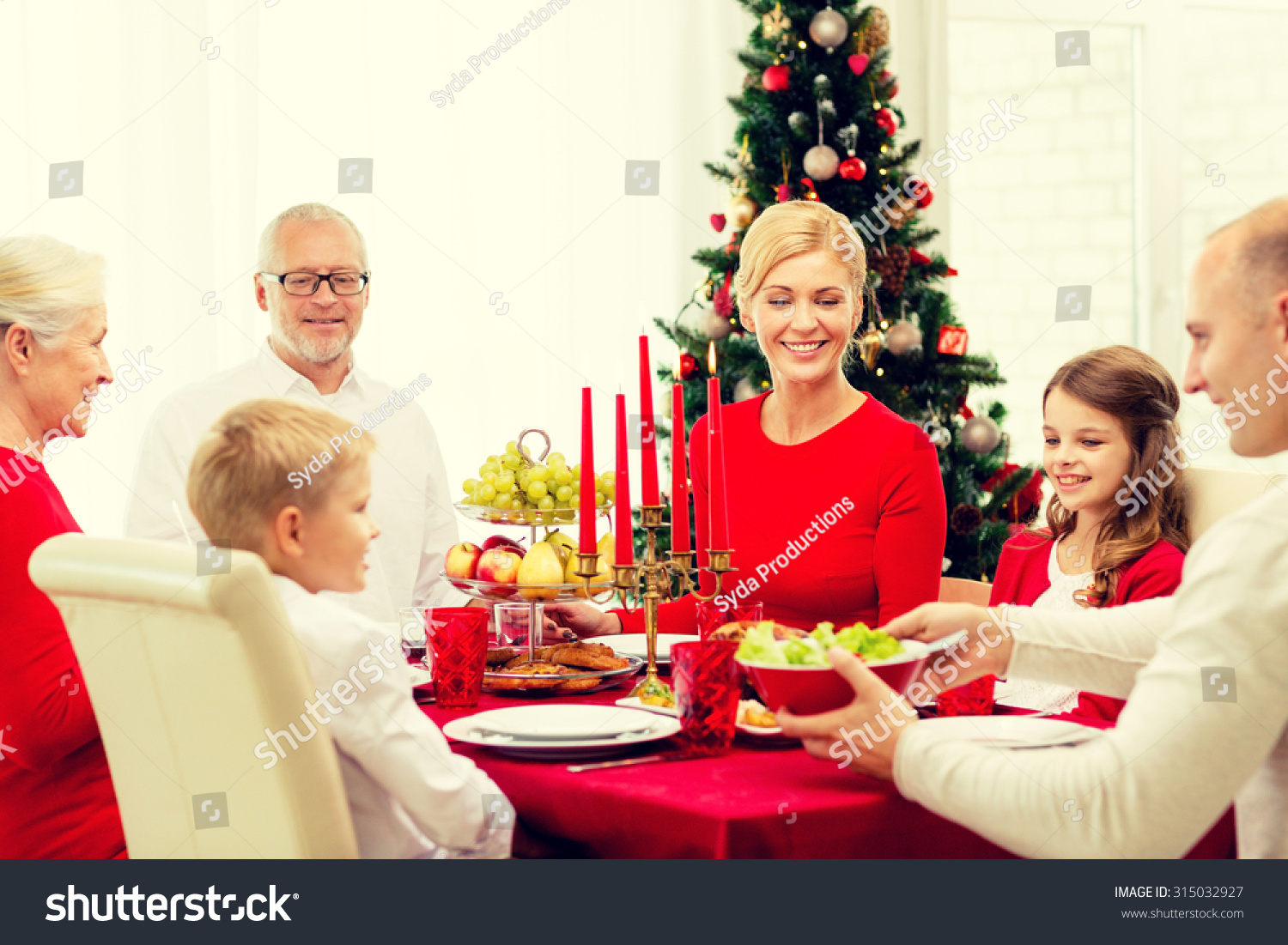 family holidays generation christmas and people concept smiling family having dinner at home