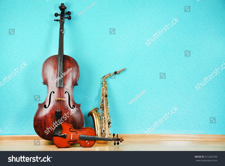 青緑色の壁紙の背景に楽器 の写真素材 今すぐ編集 315202700