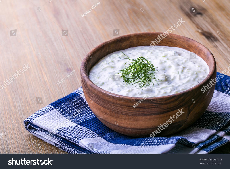 Tzatziki. Greek salad tzatziki of cucumber, yogurt or cream, olive oil ...