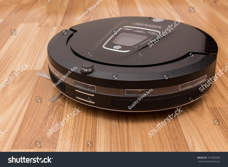 Robot Vacuum Cleaner On Laminate Wood Stock Photo