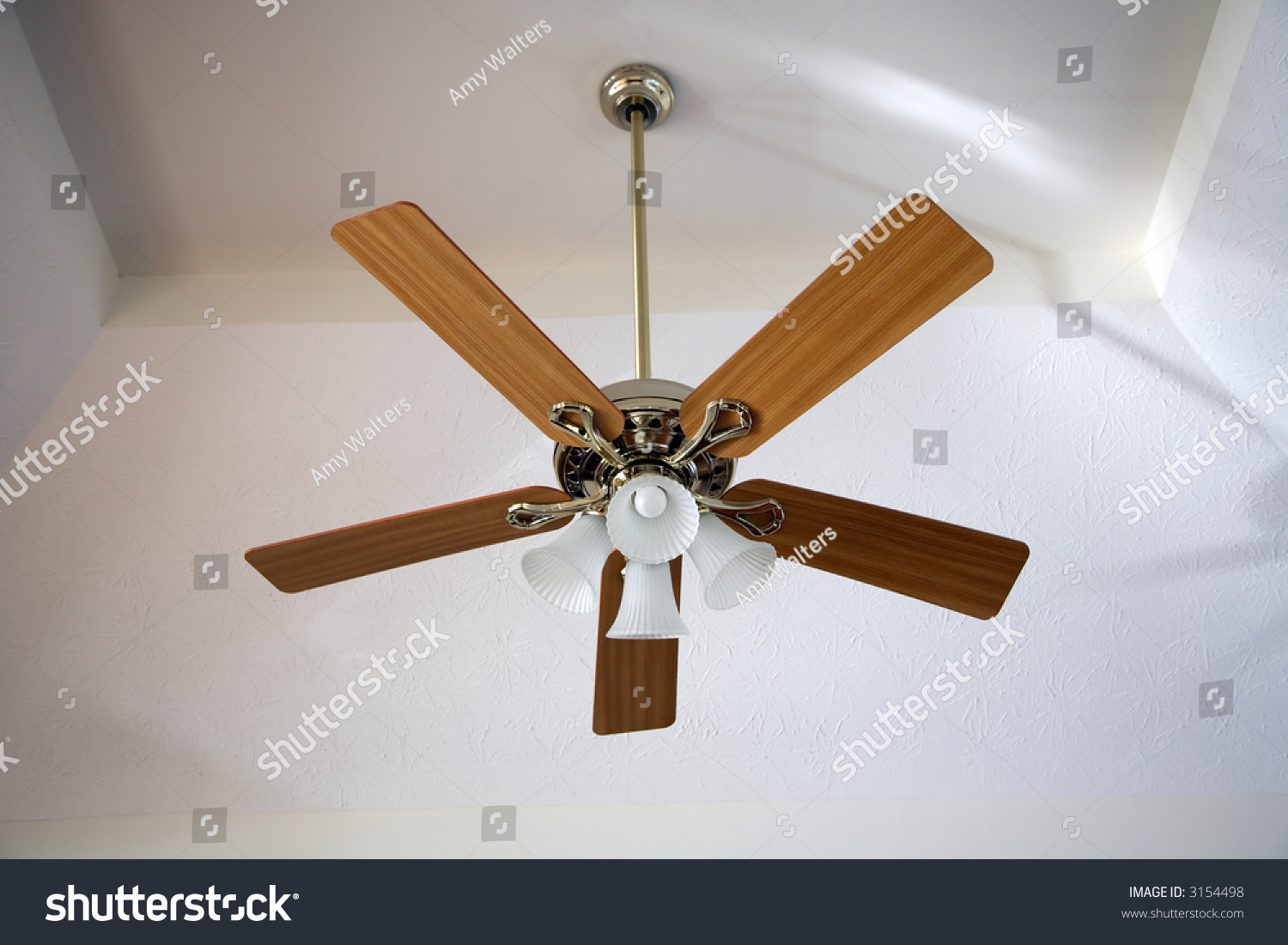 ceiling fan hanging from a vaulted ceiling stock photo 3154498 shutterstock. Black Bedroom Furniture Sets. Home Design Ideas