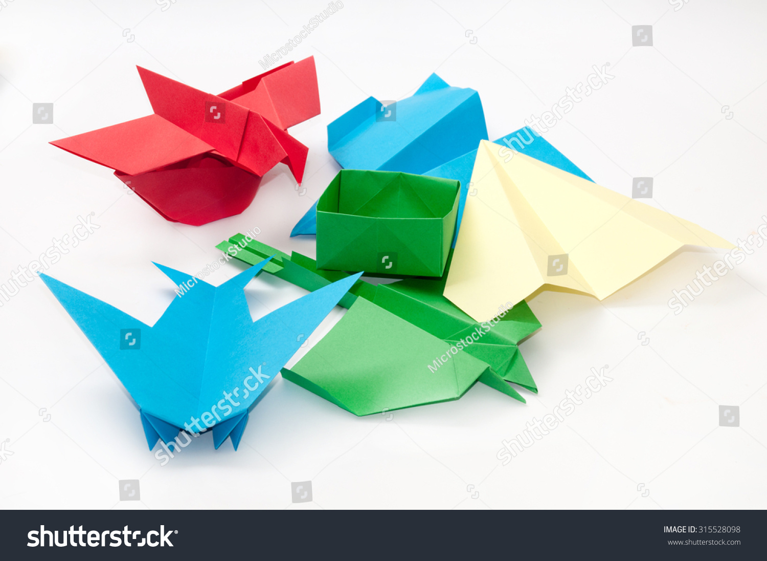 Pile bunch origami objects plane boat stock photo 315528098 pile bunch origami objects plane boat jeuxipadfo Choice Image